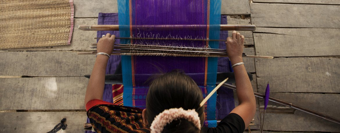 Bangladeshi woman weaving