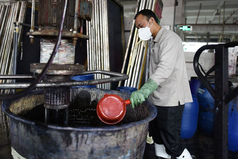 man dyeing fabric