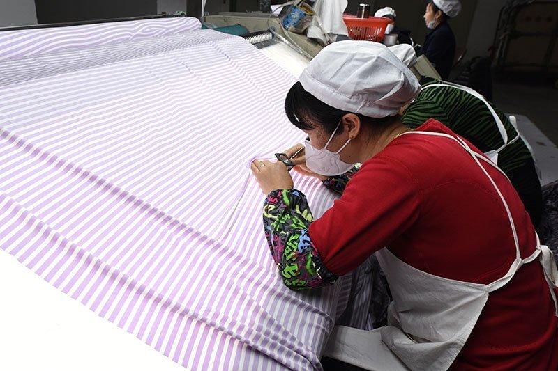 woman examining fabric