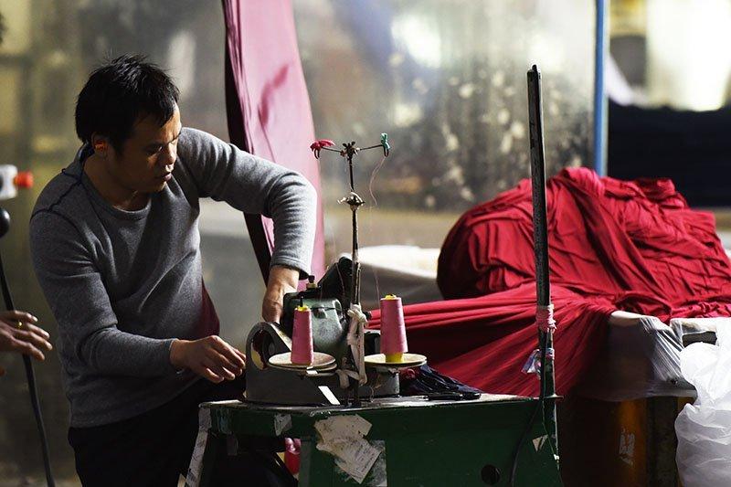 man creating fabric
